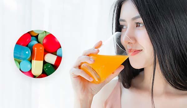 Không uống nước cam cùng với thuốc